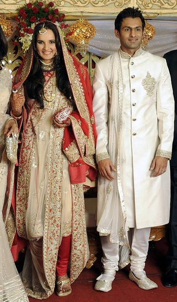 Best Indian Celebrity Bride Tennis Player Sania Mirza And Pakistani Cricketer Shoaib Malik Smile During Their Wedding Reception At A Hotel In