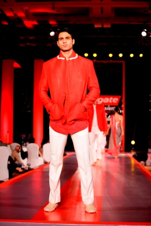 Model in Manish Malhotra's Visible White Collection in the colours of White & Red